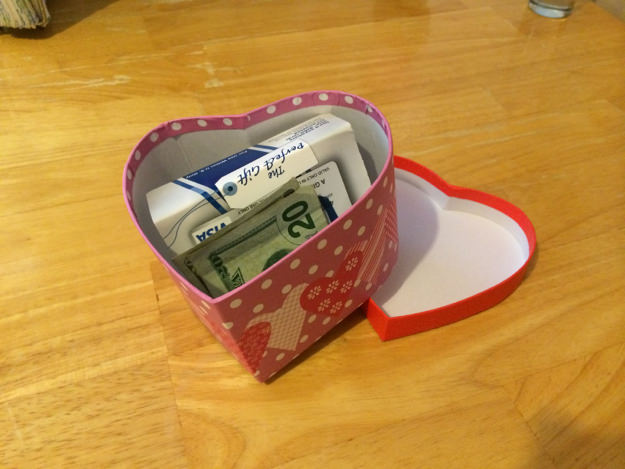 heart-shaped box with money in it